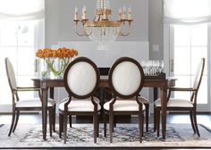 Lynnwood Dining Table - Ethan Allen  Definitely want this but for sure going to have to get waterproof chair covers on these chairs. Not fond of the fabric--hoping Ethan Allen will let me choose a different upholstery that will go with our decor a bit more.