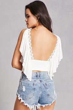 A crepe woven crop top featuring a plunging V-neckline with crochet trim, a ruffled flounce layer, a split shoulder design with dropped armholes, and a flowy silhouette.<p>- This is an independent brand and not a Forever 21 branded item.</p>