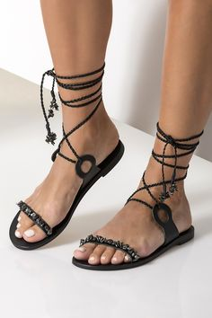 Take a chic approach to warm-weather dressing with Charis lace up sandals. They are handmade of black leather, embellished with mother of pearls in shades of gray and fasten elegantly with wraparound hand-braided straps. They are great for elevating casual outfits or grounding your formal summer outfit. Greek Chic Handmades Women's sandals are handcrafted in Athens and designed to accompany you everywhere. From the city to beach escapades & resort evenings. Find your perfect pair of Greek… Boho Sandals, Beaded Sandals, Embellished Sandals, Greek Sandals, Lace Up Sandals, Bare Foot Sandals, Gladiator Sandals, Pretty Sandals, Black Leather Sandals