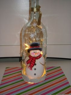 Handpainted snowman wine bottle with lights