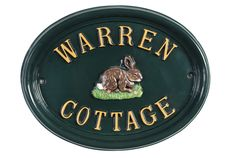 An Easter bunny on an aptly named Warren Cottage house sign.
