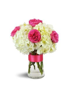 Steamy and chic! Hot fuchsia garden roses leap out from a background of sweetly feminine white hydrangea, perfect for a summer birthday or for any special fashionista!  Six stunning fuchsia garden roses are arranged with delicate white hydrangea for a modern, festive delight!