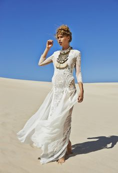 WOW. now THAT is a statement necklace!!! gorgeous fringe / metal / silk tassel / diamond / crystal / embellished statement bib necklace paired with Inca wedding dress by @Grace loves lace #GraceLovesLace | long-sleeved lace wedding gown