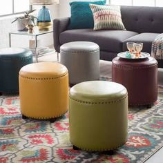 If the sleek shape and on-trend nailhead trim of the Belham Living Hutton Modern Round Nailhead Ottoman aren't appealing enough, consider its. Round Ottoman, Ottoman, Modern Round, Leather Upholstery, Leather Ottoman, Nailhead, Contemporary Living, Footstool, Ottoman Footstool