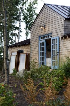 Decorative Exterior Doors house designs Rustic Exterior cabin coastal cottage coastal Maine bunkhouse cottage french doors island living lantern metal roof rustic shingle siding standing seam roof
