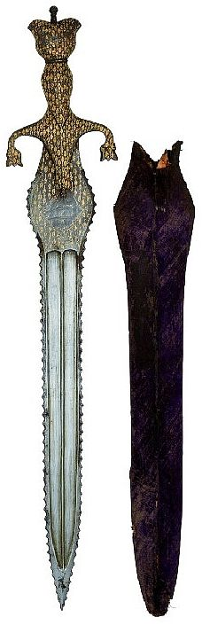 AN INDIAN DAGGER, LATE 19TH CENTURY with broad serrated double-edged blade cut with a pair of long fullers on each side, swelling at the forte and decorated with gold koftgari foliage and a calligraphic cartouche on each side, iron hilt including a pair of down-curved bud-shaped quillons, double-beaked pommel, and decorated over its surface with leafy ornament en suite with the forte, in its fabric-covered wooden scabbard 55.3cm; 21 3/4in.