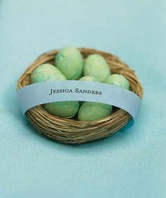 these little nests filled with mini eggs for our favours :)