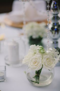Intricate flower arrangements of white roses