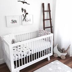 Loving all the details in this sweet, all white nursery! We love all the rustic touches, bringing a little bit of the outdoors inside! via @_kellypacker