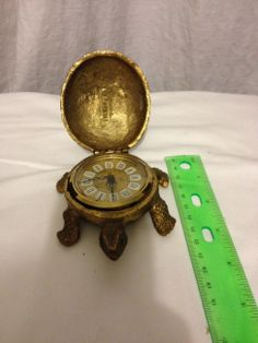 Gruber Turtle Clock - alarm clock Brass vintage 1965 Gold Colored Turtle with emerald green eyes. Top opens to show clock timepiece.
