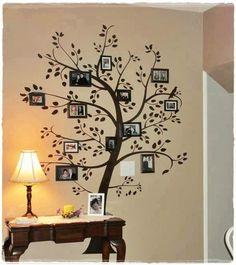 Adesivo de parede com quadros fotográficos - Guia de Casa.