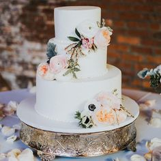 3-tier white wedding cake with pastel blooms