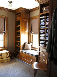 Masculine closet - dark wood - open shelves cubbies - window seat - Roman shade - Gardiner and Larson Homes