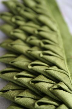 green folds.JPG by ruthsinger, via Flickr (Prairie Points?) This would look cute on a handbag.