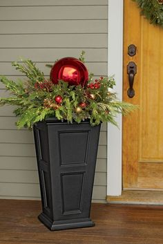 simple urn filled with evergreens, berries and ornaments