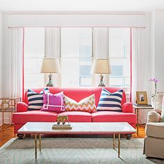Textile designer Caitlin Wilson transformed a bland apartment into a bright, upbeat space in 9 months. We love the pops of color! #preppy #decor