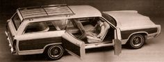 Ford Aurora II County Squire, 1969. A woody Ford station wagon with centre opening suicide doors and no B pillar on the passenger's side. And a swivelling passenger's seat