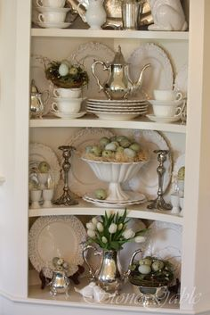 Spring Cupboard - such a pretty display of dishes, silver and Spring decor - via Stone Gable Blog