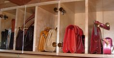 Not a fan of Handbag hooks? How about cubbies with beautful glass doors to house your handbags. Talk about a high end display! And right in your own closet!