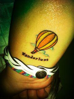 Wanderlust balloon tattoo