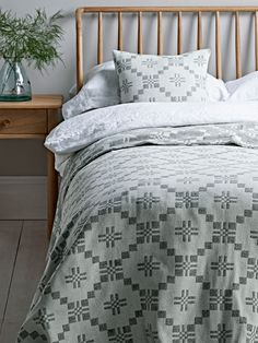 Handcrafted in the UK from pure, soft lambswool, our large cross patterned bedspread is warm white with an exquisite soft grey cross and diamond pattern. With an inverse pattern on the back, it will add a beautiful accent to your bedroom look. Pair with our Lambswool Cross Cushion - Grey Also avaliable in a smaller size - Lambswool Cross Blanket