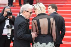 "US actress Kristen Stewart (R) talks with US director Woody Allen as they arrive on May 11, 2016 for the screening of the film ""Cafe Society"" during the opening ceremony of the 69th Cannes Film Festival in Cannes, southern France.  / AFP / Valery HACHE"