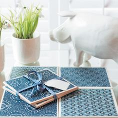 Update plain tiles then use them as coasters or trivets with these African print tiles.