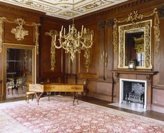 View of the Saloon at Lyme Park, with one of the carved giltwood rococo chandeliers and the contemporary harpsichord (1740s). ©National Trust Images/Nadia Mackenzie