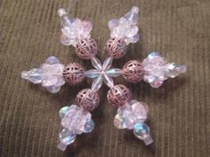 img 4257 300x225 The easiest Snowflakes of all (uses plastic earring backs for the ends).