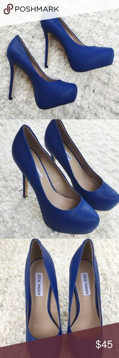 Steve Madden blue snakeskin 5 inch platform heels Steve Madden heels in excellent, almost new condition. The color is kind of a royal blue, with a texture of a very small scaley snakeskin. They are 5 inch heels and have absolutely no damage to them. Size 8 1/2! Steve Madden Shoes Platforms