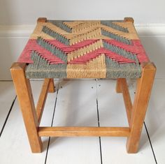 Woven stool aztec:  Small stool with wooden legs and great aztec patterned woven seat in naturals, reds and blues (faded).  H 28cm - W 28cm - D 28cm.  £38.00.  www.anartfullife.co.uk