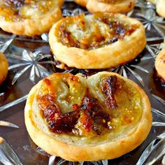 Blue Cheese, Fig, and Caramelized Onion Palmiers- With just four simple ingredients, you can have a fancy appetizer for your guests. Blue Cheese, Fig, and Caramelized Onion Palmiers will impress evenly the in-laws this holiday season!