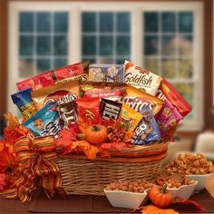"""A fun and festive way to say, """"Happy Fall"""" to all your friends and loved ones. With all the favorite American snacks included in this Fall themed gift everyone is sure to love it. Decorated with a kee"""