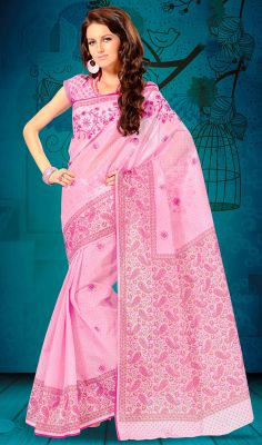 Pink Embroidered Cotton Printed Sari Look fascinatingly beautiful draped in this pink shade cotton sari. Saree is beautifully accentuated with printed and embroidered decorative patterns that gives you a pretty look. Comes with a matching stitched round neck blouse with 6 inches sleeves. #IndianDesignerCottonSarees #HandloomCottonSarees
