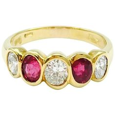 Simple but elegant five stone band from Damiani in yellow Gold. Featuring gorgeous alternating oval bezel set diamonds and rubies. 3 diamonds: approximate total weight of ct. Color: F-G, Clarity: VS 2 rubies: approximate total weight of ct. Gold Band Ring, Band Rings, Sparkle Wedding, Stone Gold, Gold Bangles, Gold Pendant, Beautiful Necklaces, 18k Gold, Wedding Rings