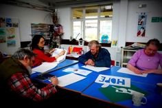 Group Activity as part of our Open Week. This is the Graffitti Workshop planning their design. http://www.headway-cambs.org.uk/
