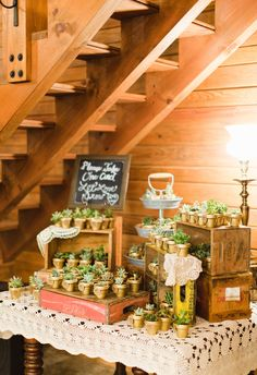Succulents as wedding favors, gold painted pots, let love grow // Clay Austin Photography