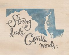 Strong Deeds, Gentle Words! The Maryland state motto is hand lettered in gray with a blue-gray watercolor shape of the state of Maryland.    This