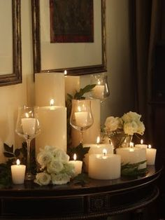 simple white candle grouping, use of wine glasses for height