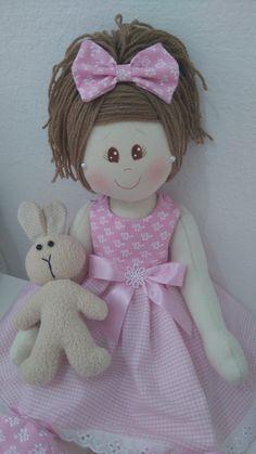 boneca com movimentos nos braços e pernas com 50cm de altura