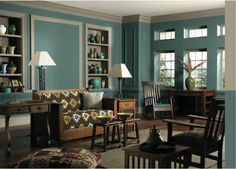 Create a serene living room with Studio Blue from Sherwin-Williams (SW 0047).