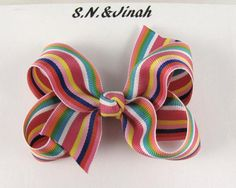 Rainbow Striped Hair Bow -Baby Toddler Girl- 3.5 inches Boutique Bow. $3.50, via Etsy.