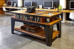 A custom worktable found in the offices of Parliament, a Portland creative company. Wood + Iron = good.
