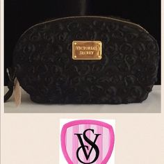 Victoria's Secret Black Cosmetic Bag This bag holds all your must-haves, and makes a pretty statement with the textured blossoms. Victoria's Secret Bags Cosmetic Bags & Cases