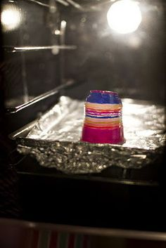 Melting a plastic cup (colored with Sharpie) in a 300 degree oven for 1-2 minutes. Poke a hole in the top, and you have an ornament!