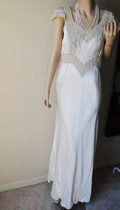 Hey, I found this really awesome Etsy listing at http://www.etsy.com/listing/153211248/long-satin-and-lace-ivory-1940s