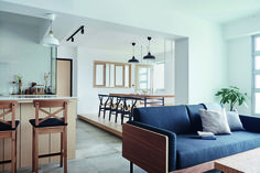 Bright and airy four-room HDB BTO home with lots of white and wood along with simple but sleek furnishings.
