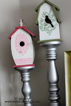 bird houses on top of tall candlesticks - easy spring decor for the buffet table