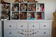 I like how this idea on the top of the bureau saves space by creating storage.