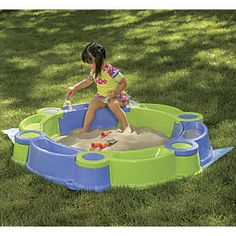 "2-In-1 Sand n Water Play Set: Its a pool, its a sand pit, its both! Use this clever modular play set as a pool with sand pit border or a sandbox surrounded by water. This ingenious 2-in-1 includes a 7 1/2""H x 48"" diameter basin, six snap-together border cubbies, four sand toys, two toy boats, and a keep-clean PVC cover. Best of all, the cubbies stack together for compact, off-season storage..."